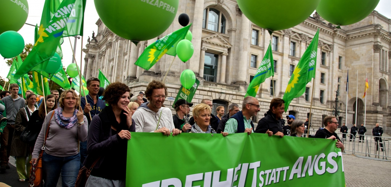 German Green Party supporters marching through the street.