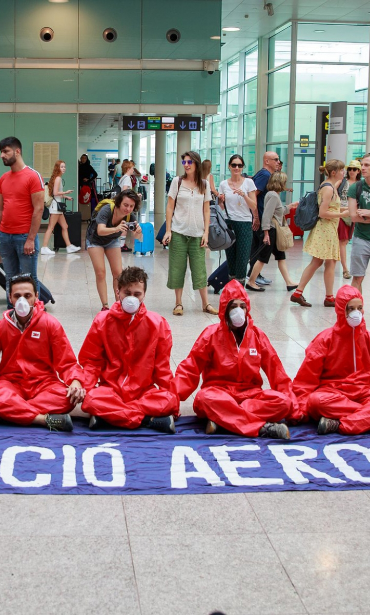 Stay Grounded protesters make a red line at Barcelona Airport