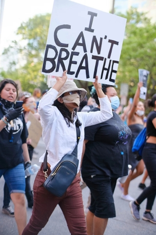 Protestor holds an 'I Can't Breathe' sign