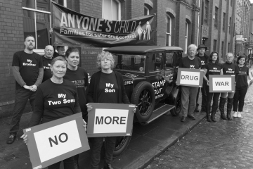 Anyone's Child campaigners with placards reading 'No More Drug War'