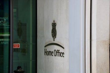 A Home Office logo on a wall.