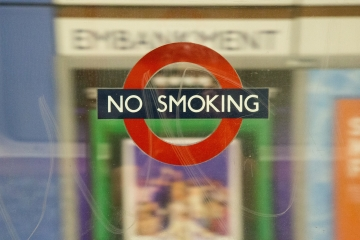 A 'No Smoking' sign on the London Underground.